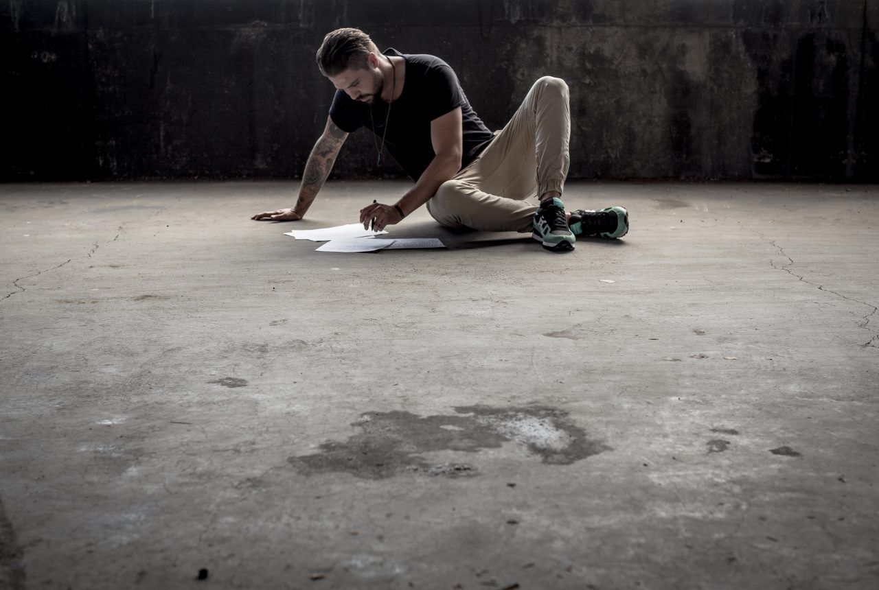 man drawing on the floor